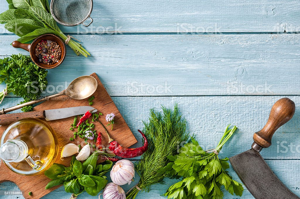 fresh herbs and spices on wooden table stock photo