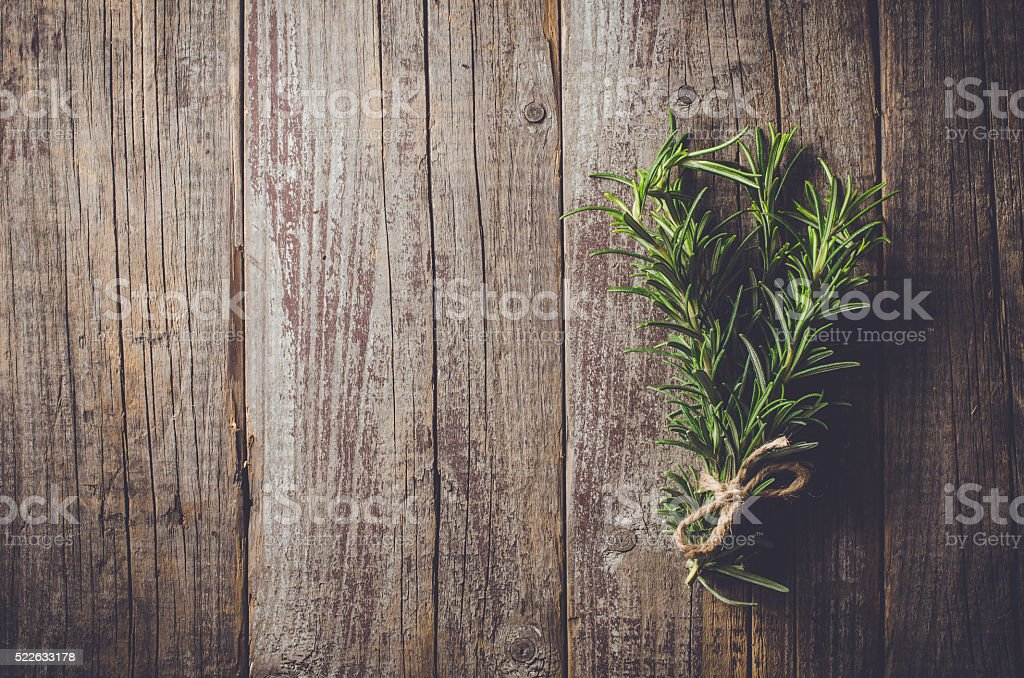 Fresh herbs from garden on wooden table stock photo