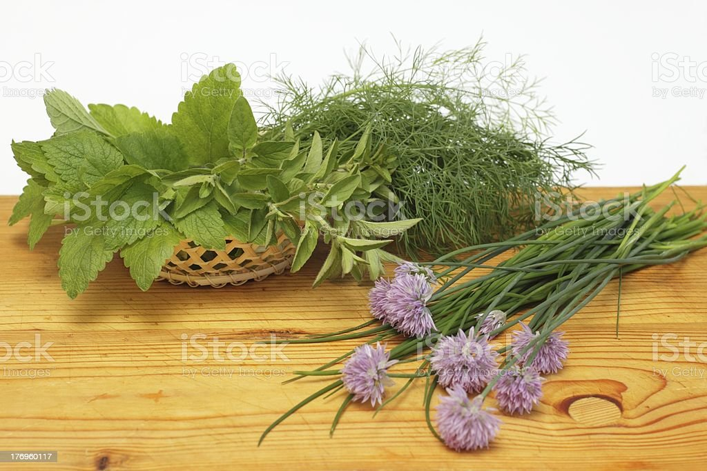 Fresh herbs in a basket stock photo