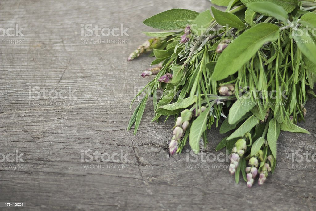 Fresh herbs on an old wooden table stock photo