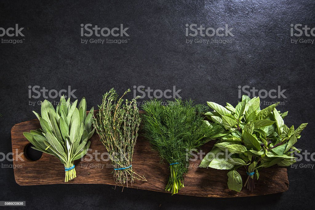 fresh herbs on wooden board border background stock photo