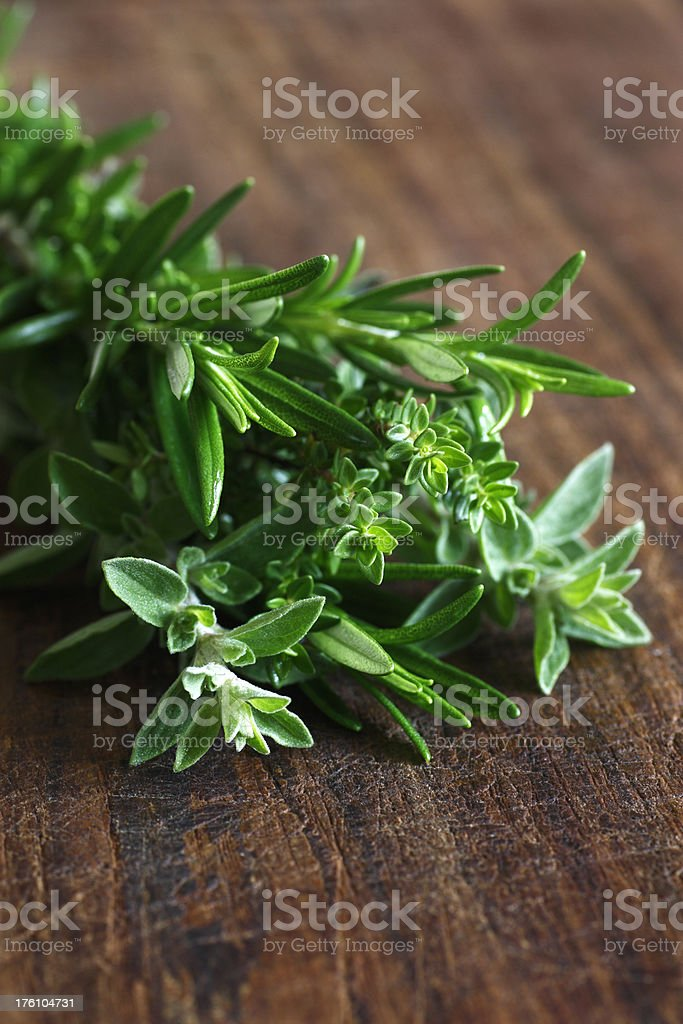 fresh herbs on wooden board royalty-free stock photo