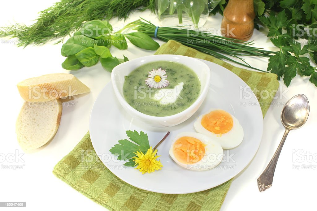fresh herbs soup with a dollop of cream royalty-free stock photo