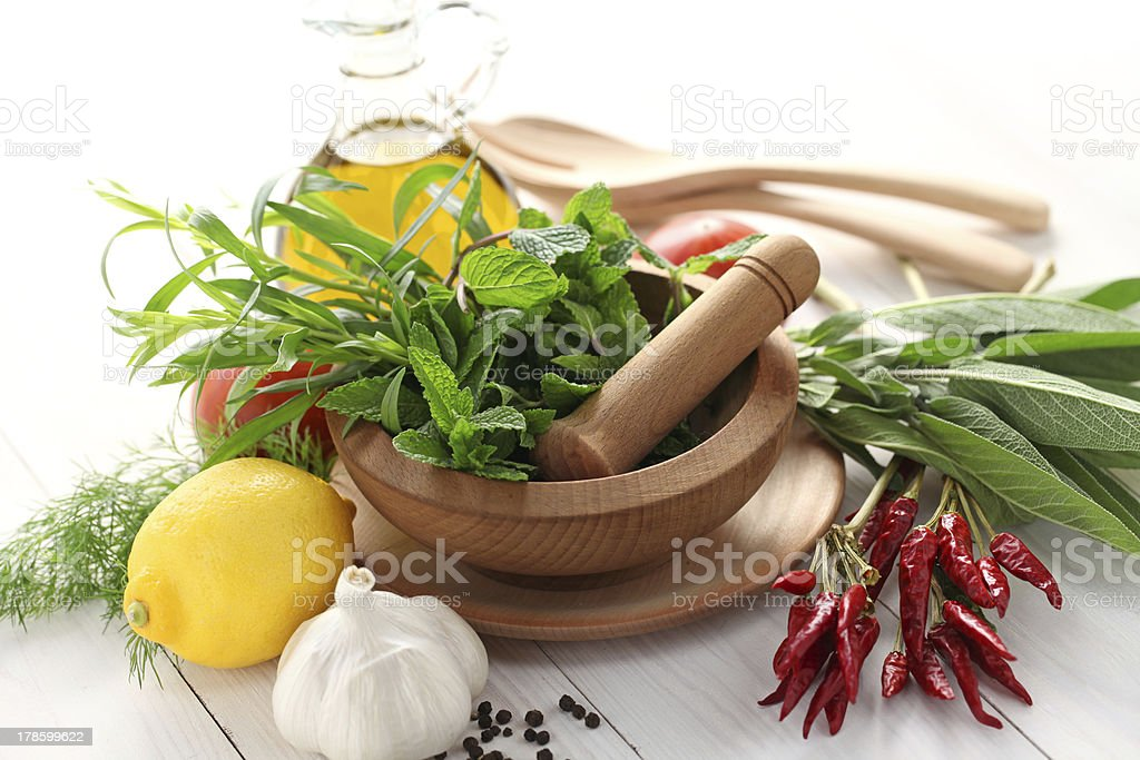 fresh herbs with mortar and pestle royalty-free stock photo