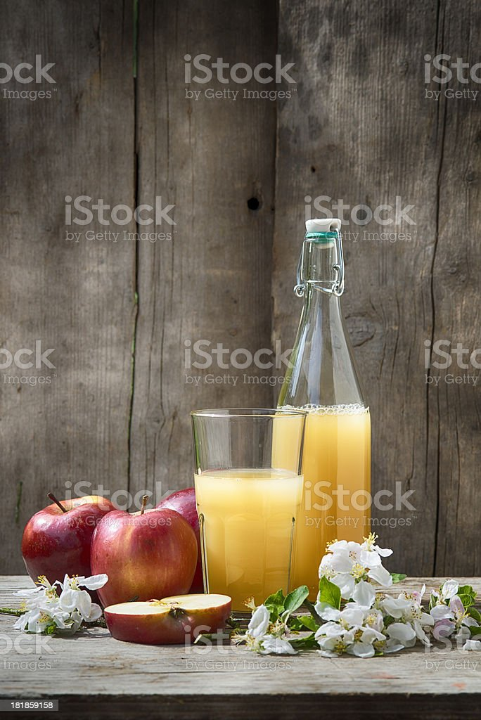 Fresh homemade apple juice in a glass & bottle with apples stock photo