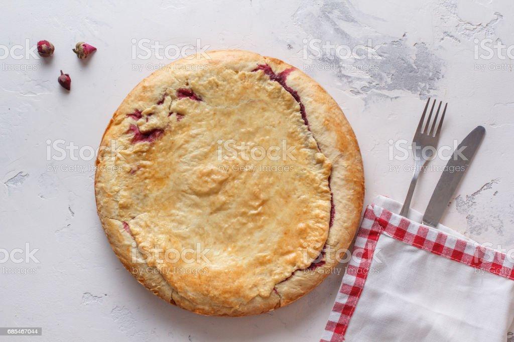 Fresh homemade cherry pie on a white background. stock photo