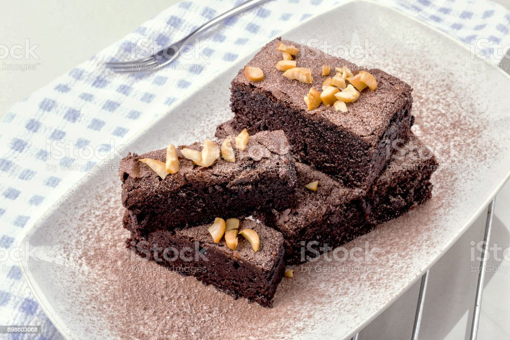 Fresh Homemade Chocolate Brownie against a background stock photo