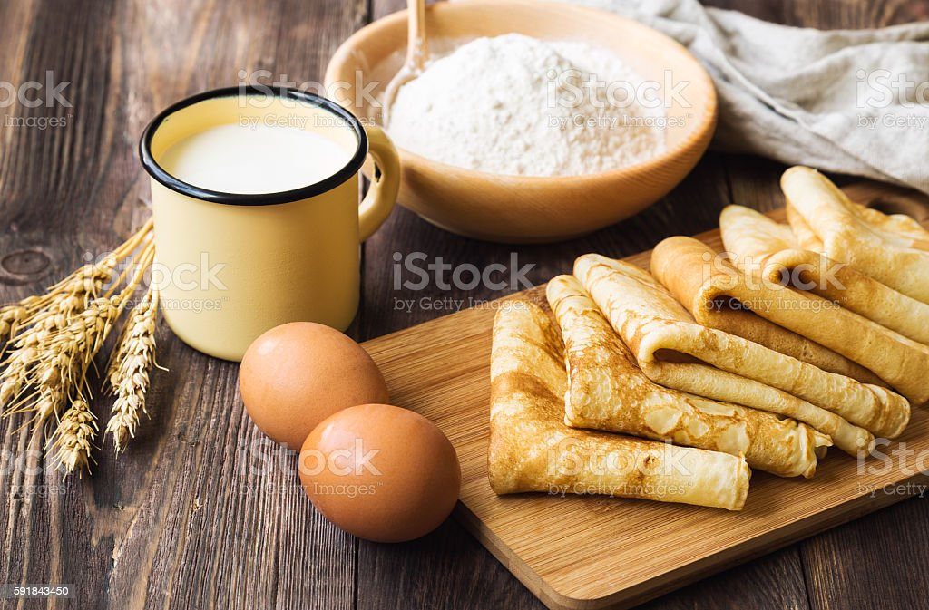 Fresh homemade crepes with ingredients stock photo