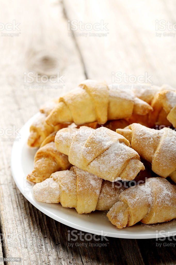 Fresh homemade croissants on a grey wooden table stock photo