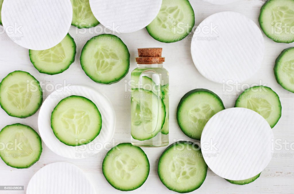 Fresh homemade cucumber facial toner in bottle, stock photo