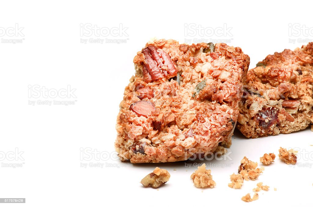 Fresh homemade flapjack oat cake with seeds isolated over white. stock photo