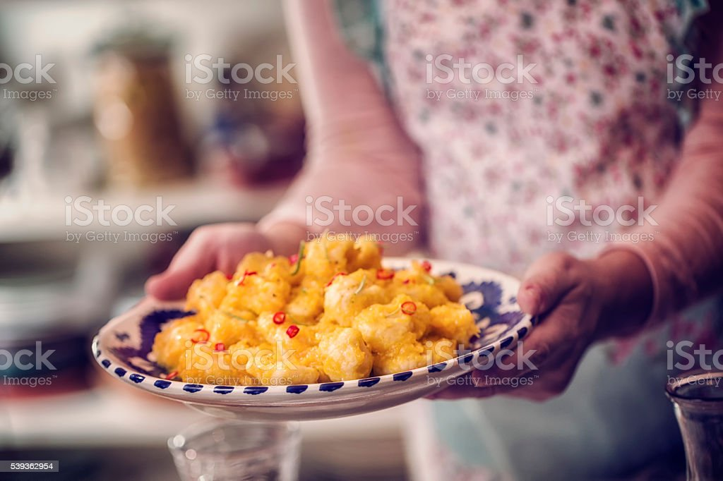 Fresh Homemade Gnocchi with Pumpkin Sauce and Chili Pepper stock photo