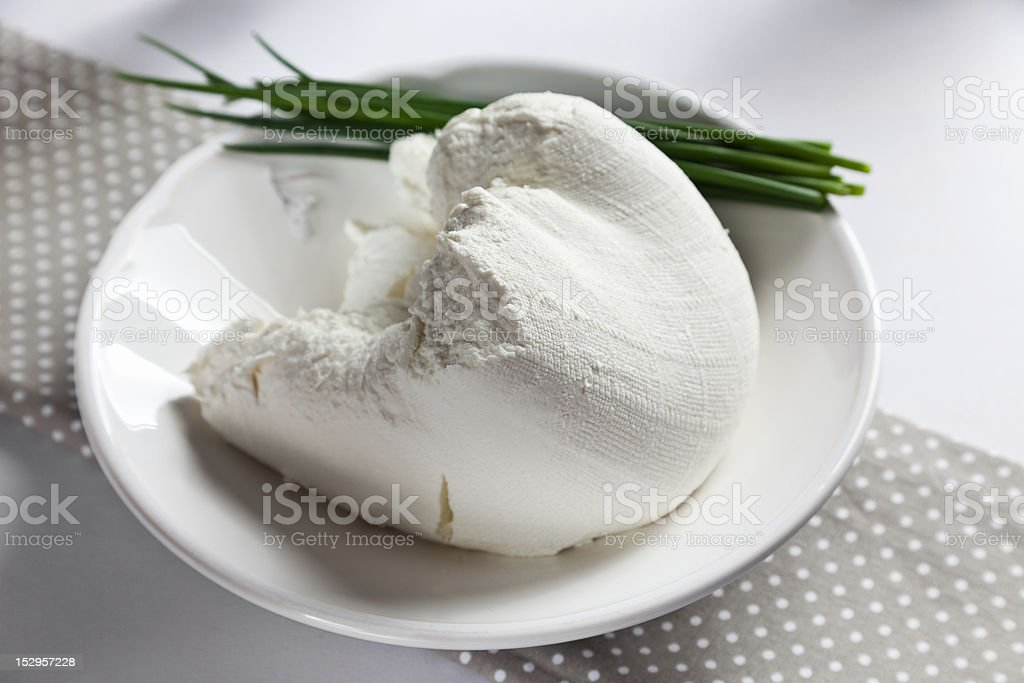 Fresh homemade goat cheese with chives royalty-free stock photo