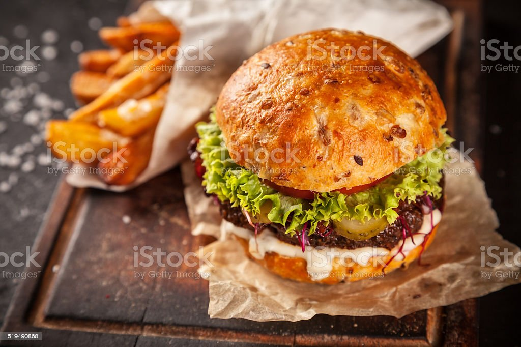Fresh home-made hamburger served on wood stock photo