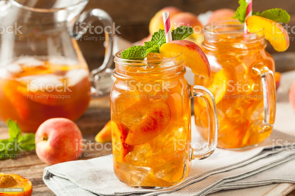 Fresh Homemade Peach Sweet Tea stock photo