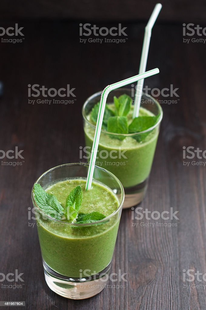 fresh homemade smoothie with spinach and bananas stock photo