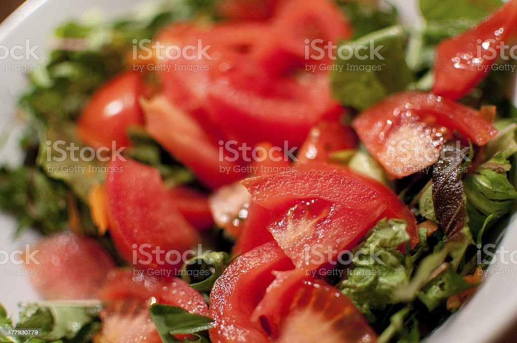Fresh homemade tomato and lettuce salad stock photo