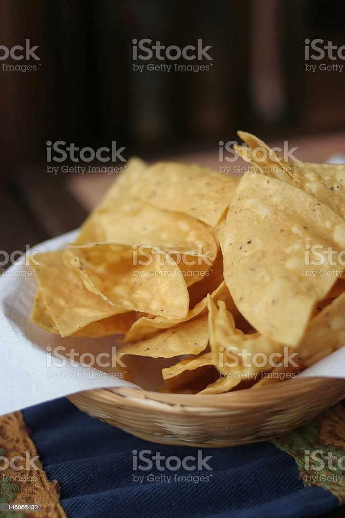 fresh homemade tortilla chips on mexican table runner stock photo