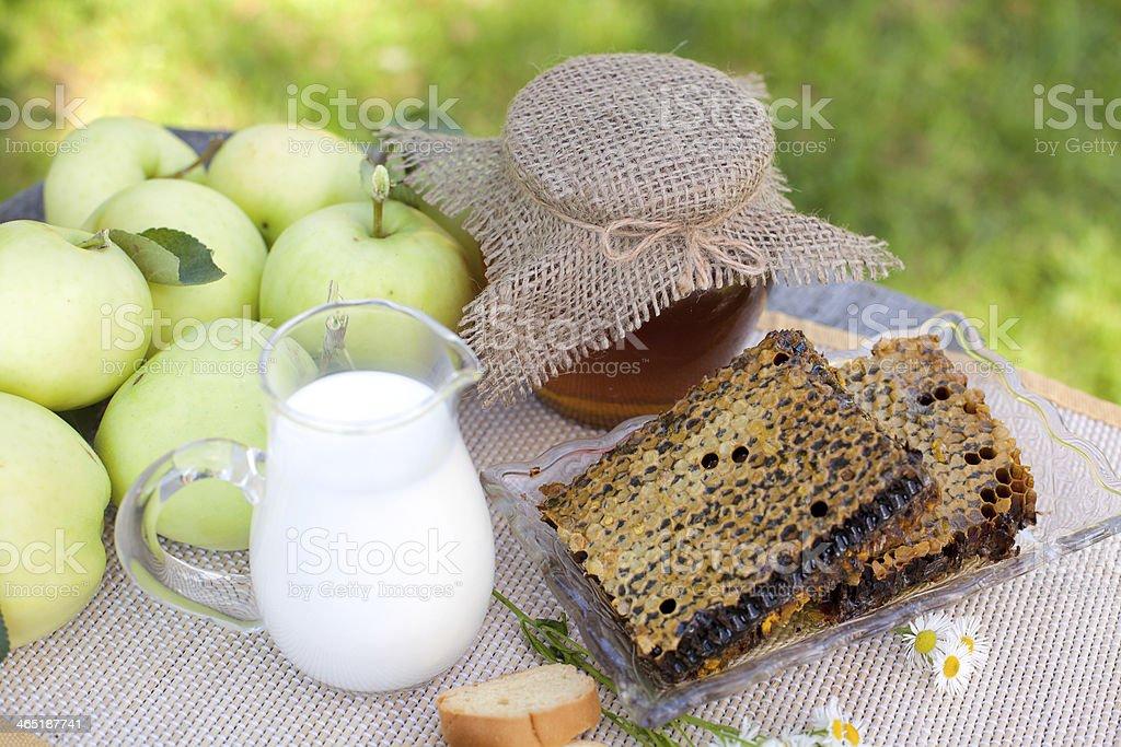 fresh honey combs, milk and apples stock photo