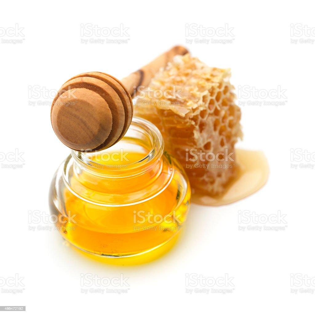 Fresh honey in a jar and honey dipper stock photo