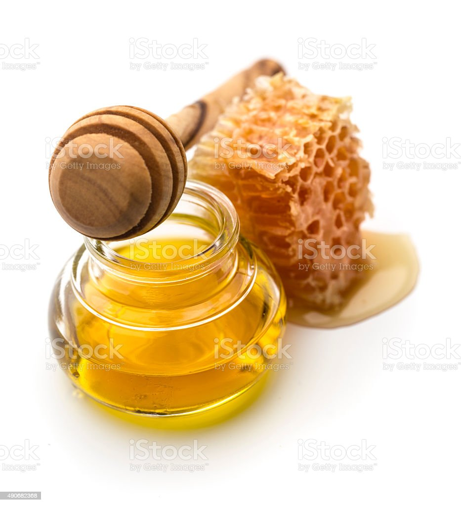 Fresh honey in a jar and honey dipper stock photo
