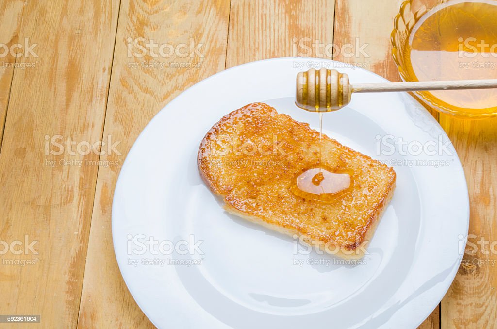 fresh honey with a stick stock photo