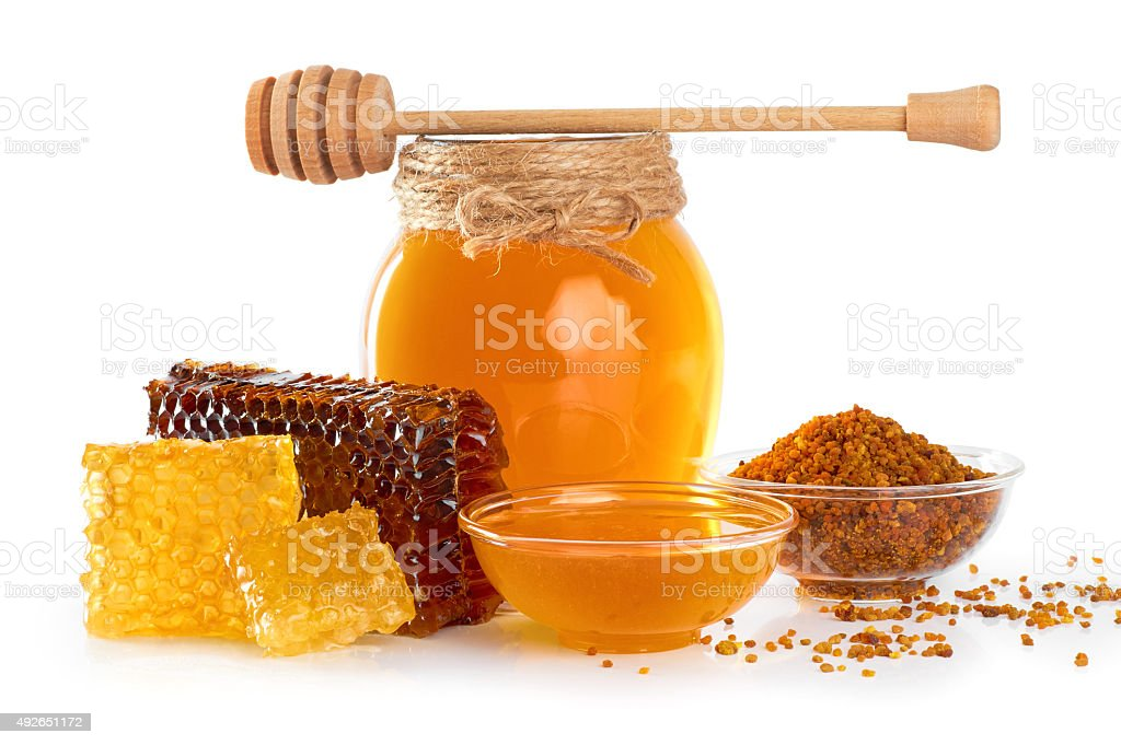 Fresh honey with honeycomb and pollen isolated on white backgrou stock photo