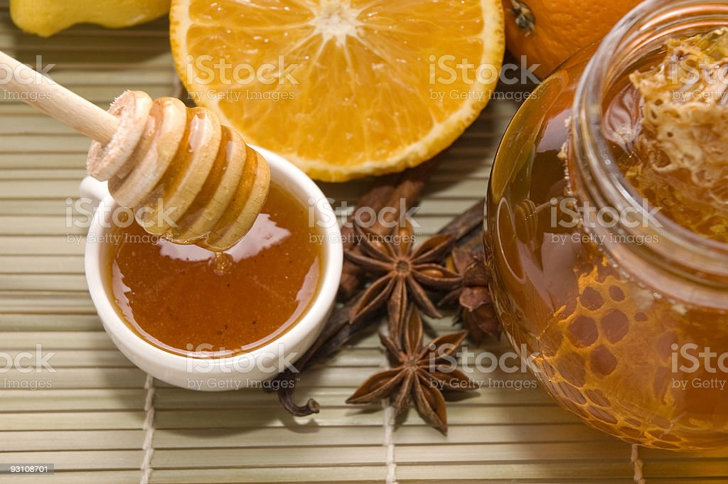 fresh honey with honeycomb, spices and fruits stock photo