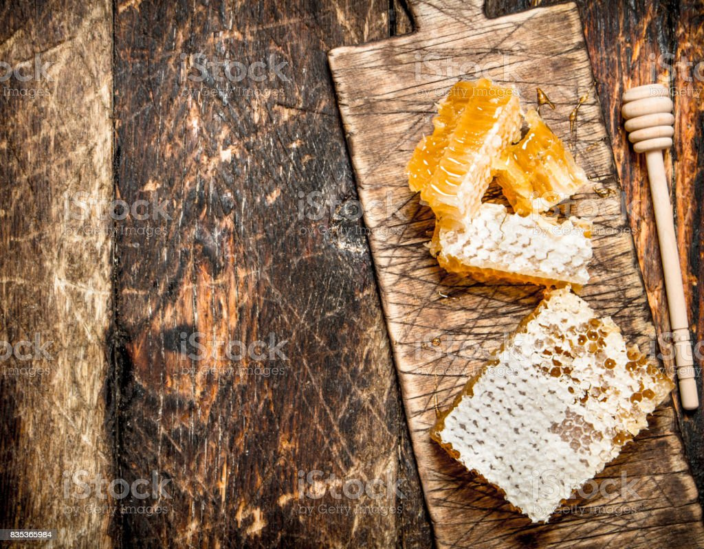 Fresh honeycomb on the Board. stock photo