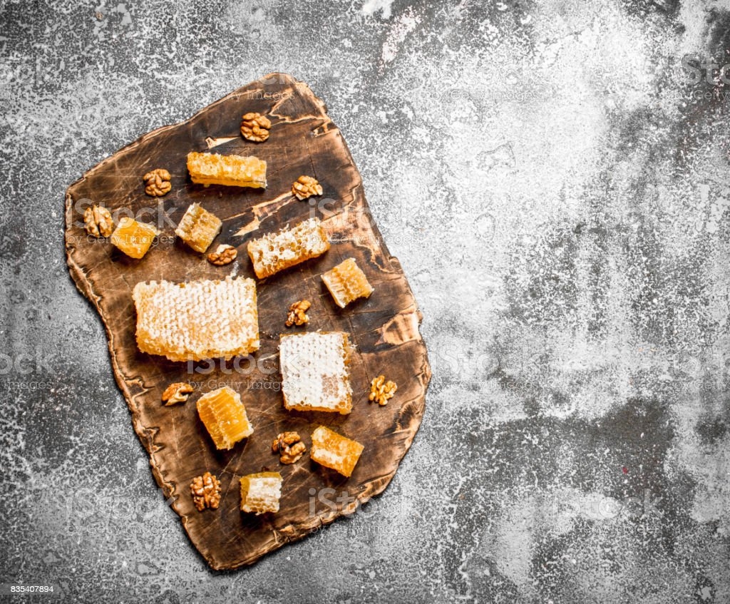 Fresh honeycomb with nuts. stock photo