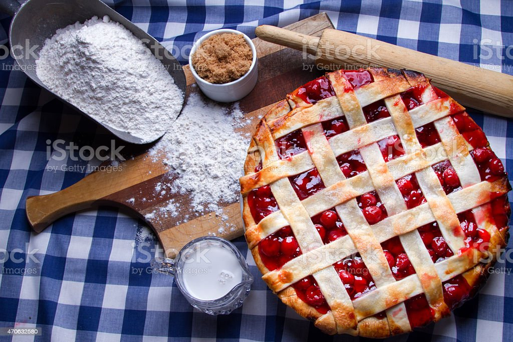 Fresh Hot Homeade Cherry Lattice Pie with Ingredients stock photo