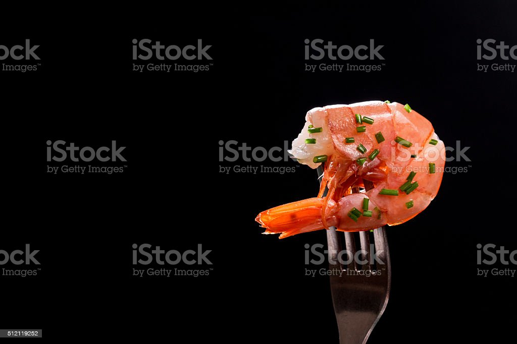 fresh hot shrimps with onion on black background stock photo