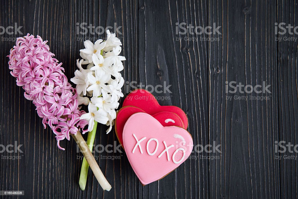 fresh  hyacinths and biscuits in the shape of a heart stock photo