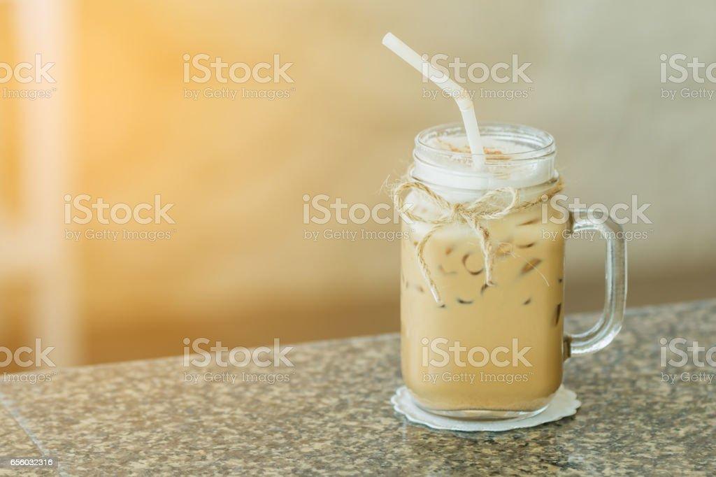 Fresh ice coffee in big glass with sunshine stock photo