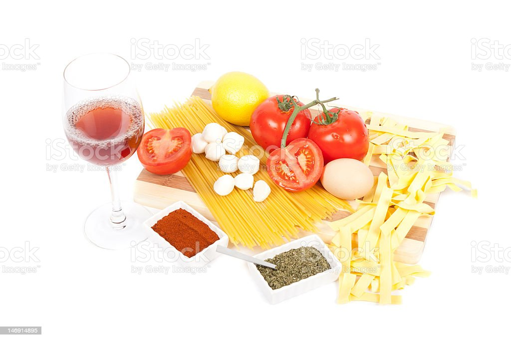 fresh ingredients for pasta near a glass with red wine royalty-free stock photo