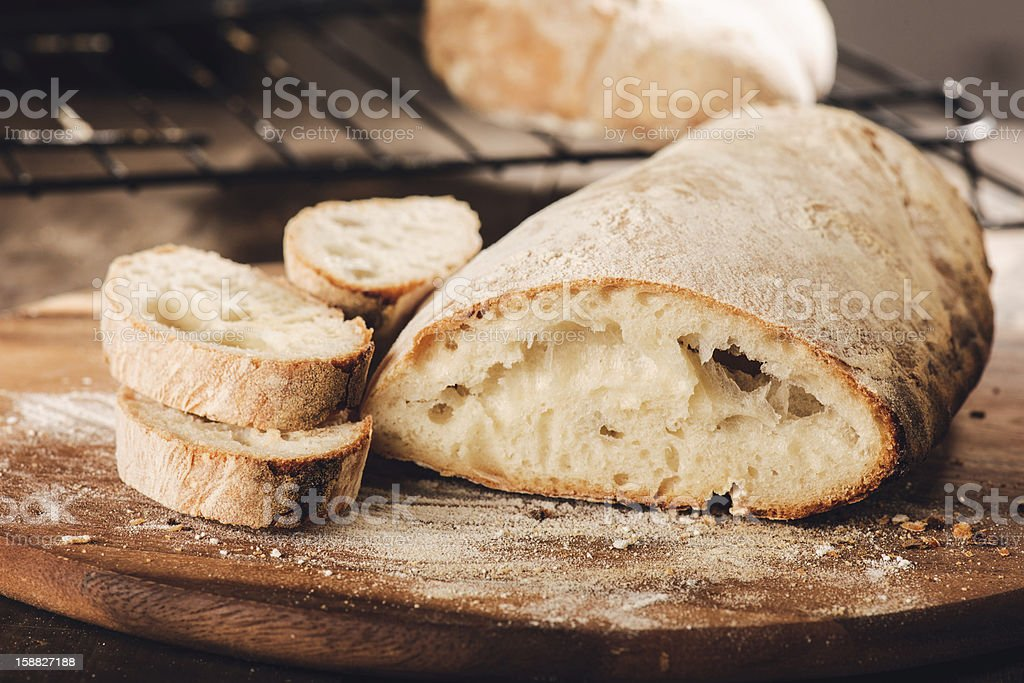 Fresh Italian bread on a cutting board stock photo