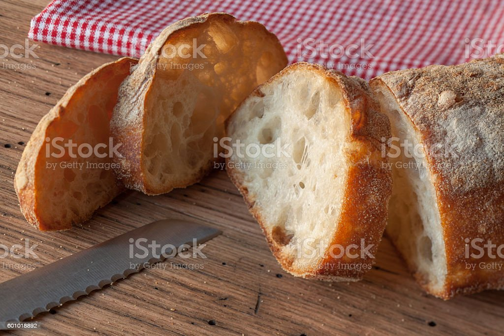 Fresh Italian ciabatta bread on wood table stock photo