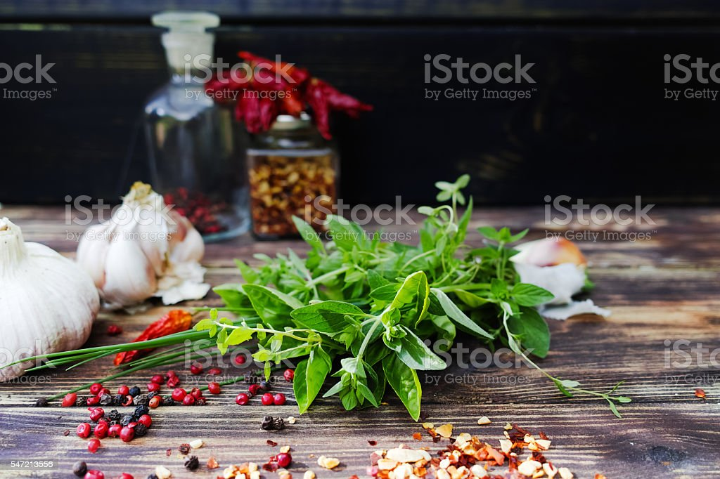 Fresh italian herbs, garlic and  dried red hot chili peppers stock photo