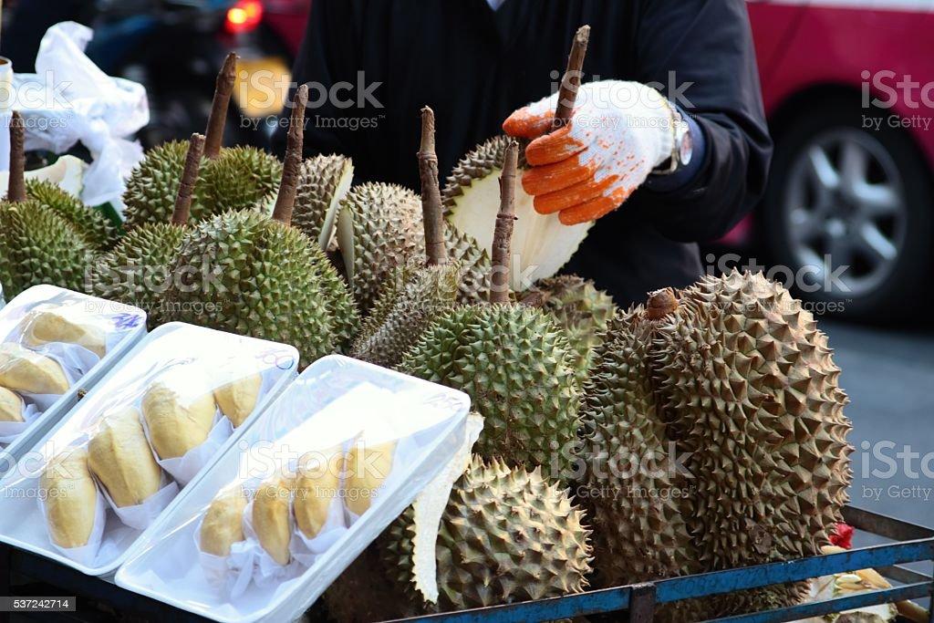Fresh jackfruits on the street market. stock photo