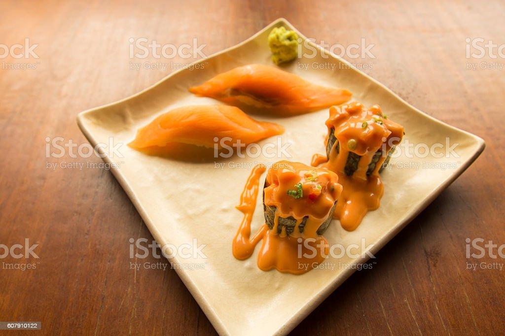 Fresh japanese salmon sushi and Salmon roll stock photo