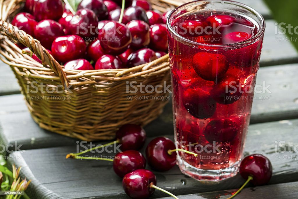 Fresh juice made of sweet cherries and ice stock photo