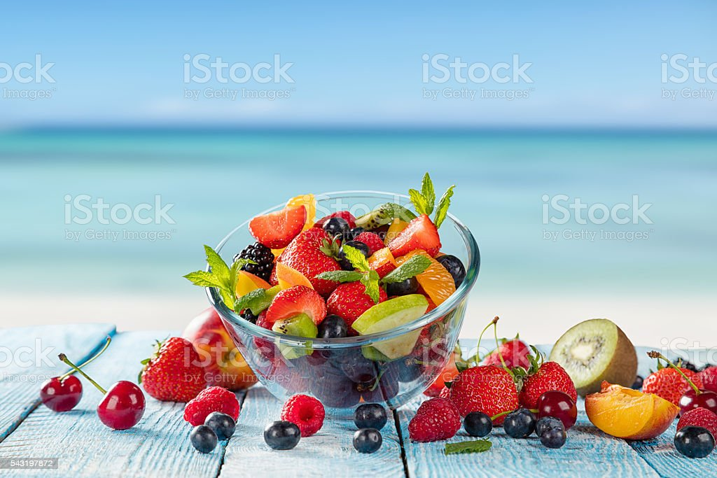 Fresh juice with fruit mix on the beach stock photo