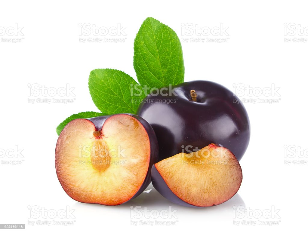 Fresh juicy organic plum with green leaf stock photo