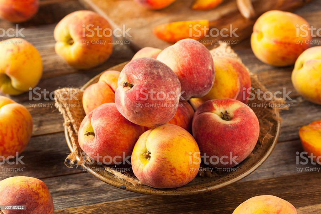 Fresh Juicy Organic Yellow Peaches stock photo