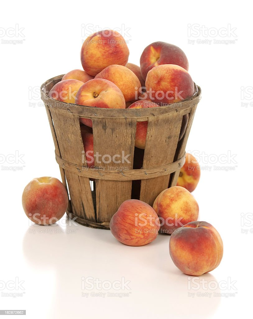 Fresh Juicy Peaches in a Rustic Farm Basket stock photo