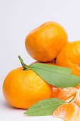 Fresh juicy ripe tangerines, isolated on a white background