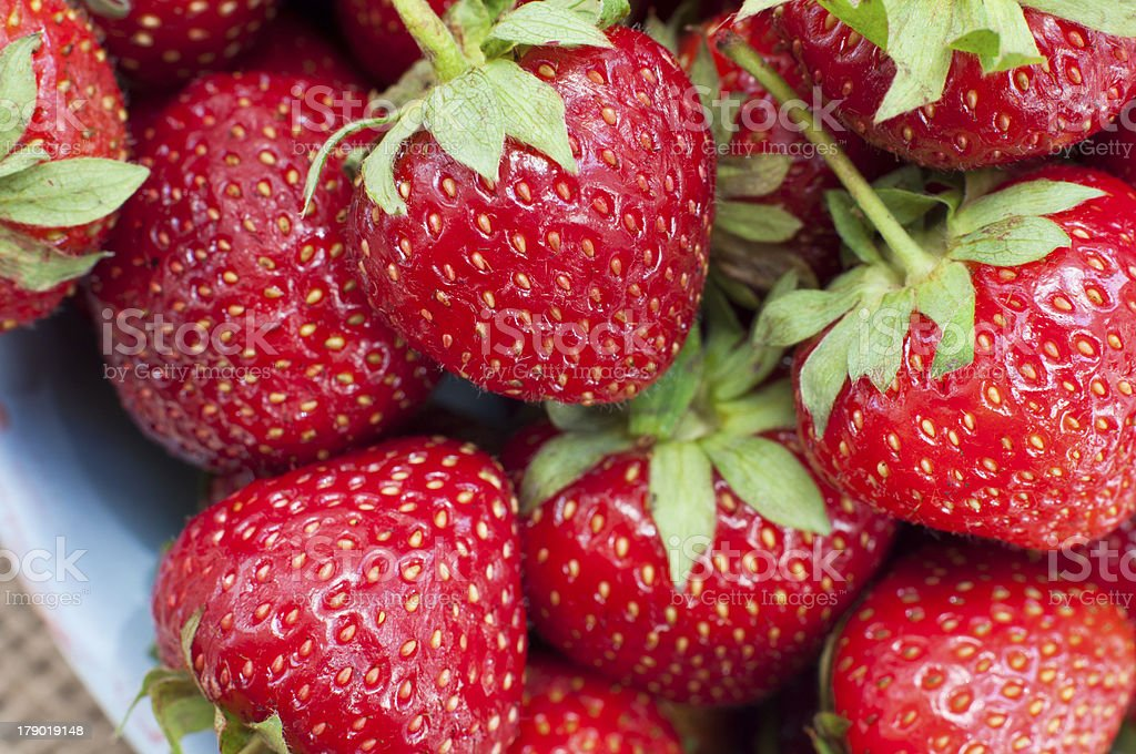 Fresh juicy strawberry closeup - Food Frame Background stock photo