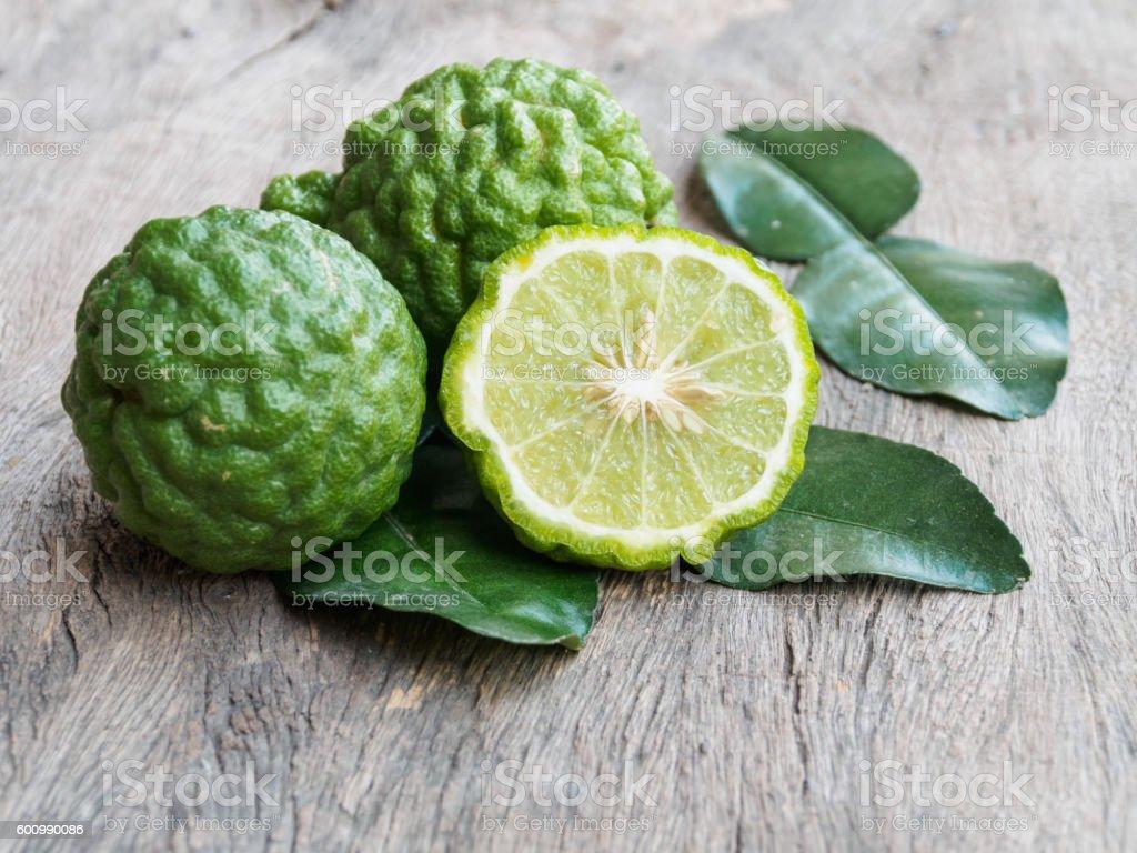 Fresh kaffir lime vegetable on wooden background stock photo