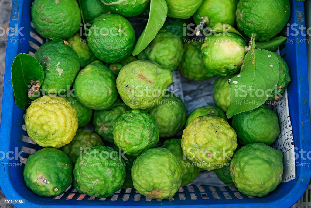Fresh kafir lime selling at local sunday market. stock photo