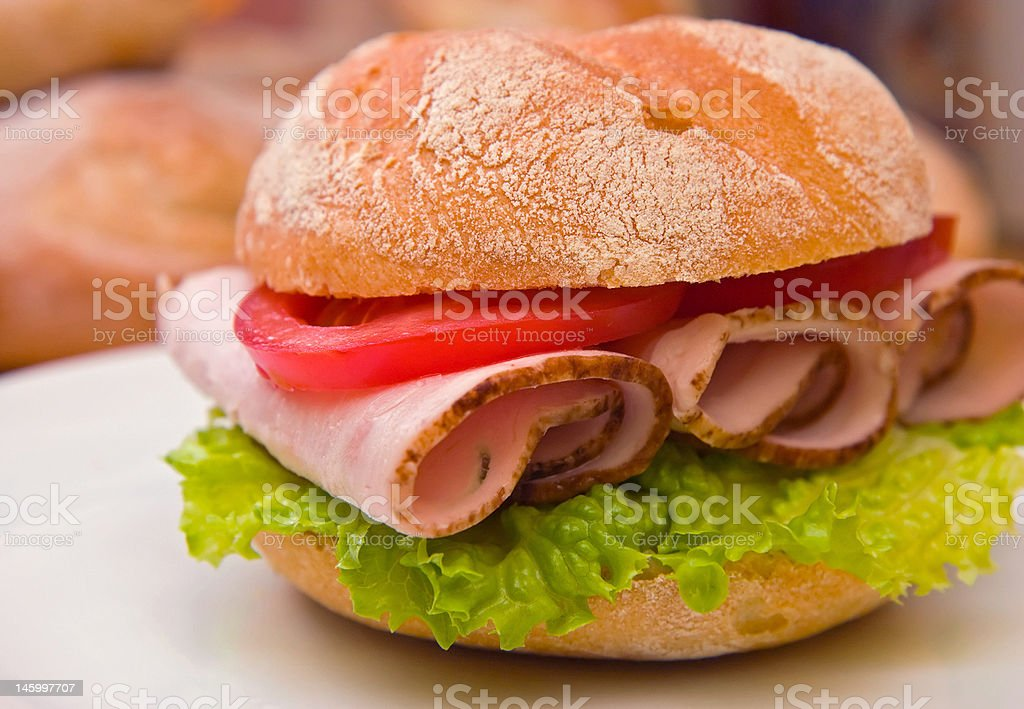 Fresh kaiser bun with turkey/chicken breast, lettuce and tomatoes stock photo